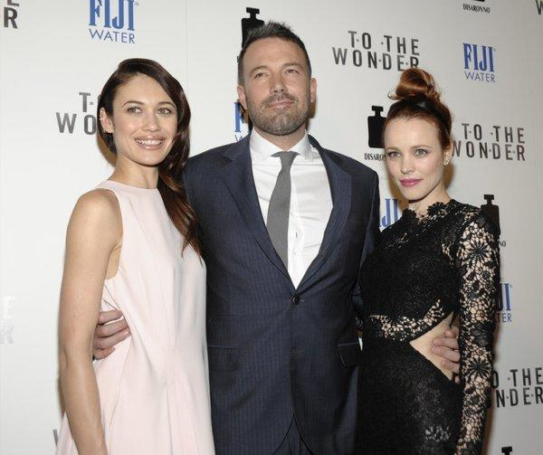 "Olga Kurylenko, left, Ben Affleck, and Rachel McAdams arrive at the premiere of ""To the Wonder."""