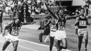 The boos and the catcalls echoed as Tommie Smith and John Carlos walked off the medal stand in the summer of 1968, track shoes in their hands to symbolize the poverty of their youth. The noise reached a crescendo as they stepped into a tunnel labeled the dungeon in the bowels of Estadio Olímpico Universitario in Mexico City.