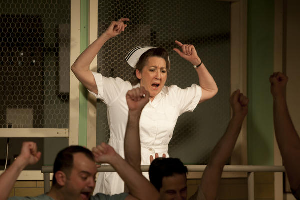 "South Bend Tribune/JAMES BROSHER Nurse Ratched (Melissa Gard) screams as she is unable to dictate her will on the ward patients as they watch an imagined World Series after the television is turned off during a dress rehearsal for ""One Flew Over the Cuckoo's Nest"" on Monday, April 8, 2013, at the South Bend Civic Theatre. via FTP"