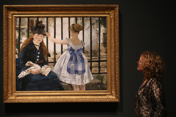 "A woman admires ""The Railway,"" a painting by Edouard Manet at the Royal Academy of Arts on Jan. 22, 2013, in London, England. The painting features in the Royal Academy's new exhibition 'Manet: Portraying Life' which displays more than 50 paintings spanning his career."