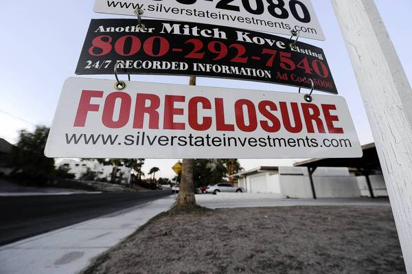 As banks pulled back on lending during the recession, the Federal Housing Administration's role in the market expanded. Now its long-term finances are being dragged down by bad loans it backed from 2007 to 2009. Above, a foreclosure sign at a bank-owned home for sale in Las Vegas in 2010.