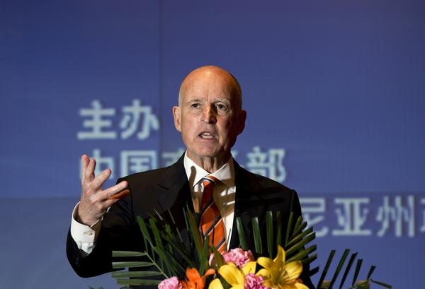 California Gov. Jerry Brown speaks before signing a memorandum of understanding with Chinese Vice Minister of Commerce Wang Chao on Wednesday.