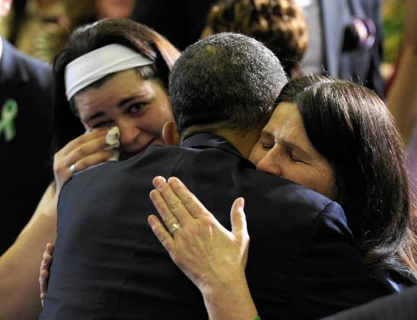 President Obama hugs Newtown family members after speaking in Hartford, Conn. on Monday about the need for greater gun-control laws.