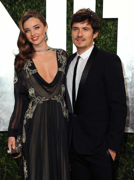 Victoria's Secret model Miranda Kerr, left, and husband Orlando Bloom at the Vanity Fair Oscars party in February.