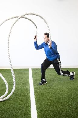 Start in a lunge position with your hands in front of your body. Start with both ropes in the 6 o'clock position. Rapidly alternate hands from 6 o'clock to 12 o'clock. While your hands are moving, perform alternating lunges. For an advanced method, try jumping up and landing in the lunge position while keeping your hands moving on the ropes.