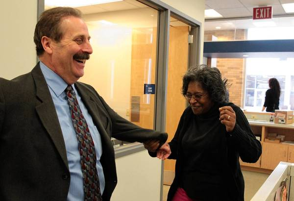 Waukegan Mayor-elect Wayne Motley dances with well-wisher Lori McBride on Wednesday in the city clerk's office in Waukegan, a day after elections.