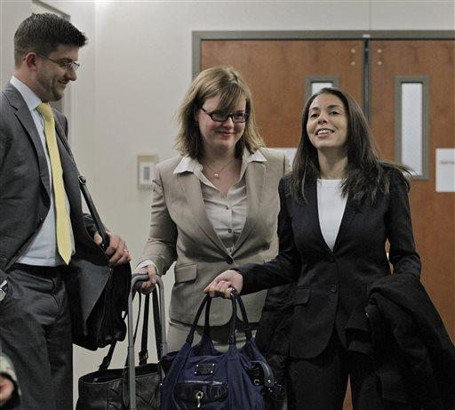 Fox reporter Jana Winter, right, and her attorneys arrive for a hearing for Aurora theater shooting suspect James E. Holmes in Centennial, Colo., where defense attorneys want her to divulge her sources.