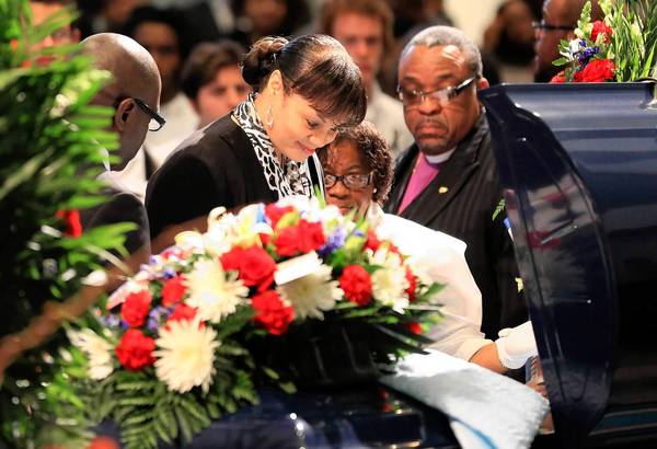 Sharon Massenburg at the casket of her son, Joseph, during his funeral Wednesday in Harvey.