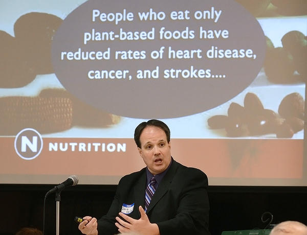 Chris Holland, pastor at the Seventh-day Adventist Church on Robinwood Drive, speaks about health and faith at a forum Wednesday night at the Hagerstown Church of the Brethren.