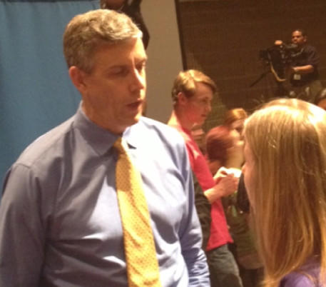 U.S. Secretary of Education Arne Duncan talks with Tyler Davis, a teacher at Dundalk High School, after Wednesday's town hall meeting at Loch Raven High School.