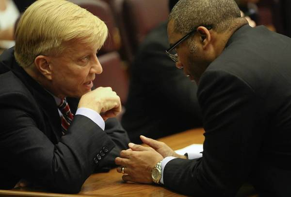 Ald. Bob Fioretti, 2nd, left, talks with Ald. Walter Burnett Jr., 27th, at Wednesday's City Council meeting.