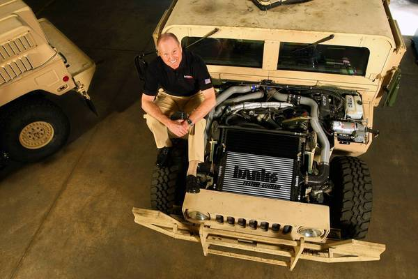 Gale Banks, a Southern California automotive aftermarket legend, next to a Humvee at his headquarters in Azusa. Banks is using his expertise to rev up the horsepower on the Army's underpowered Humvees.