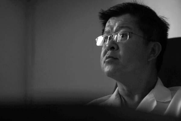Dr. Van H. Vu is shown during an interview with the Los Angeles Times. He was featured in a Times investigative report in November 2012 because 16 of his patients had fatally overdosed on drugs he prescribed. Another of his patients, Wayne Oviatt, fatally overdosed in January.