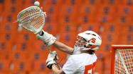 No. 5 Cornell missed a shot with 20 seconds left that would have tied the game, and host No. 7 Syracuse held on for a 13-12 win Wednesday night in men's lacrosse.