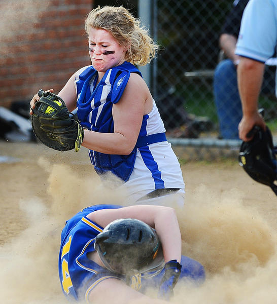 Clear Spring's Kristen Mellott slides into home plate under the tag of Boonsboro catcher Nataelie Tobery on Wednesday during the Blazers' 15-4 victory.
