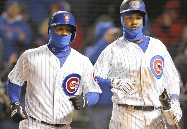 Cubs infielders Alberto Gonzalez, left, and Starlin Castro donned balaclavas for Tuesday night's game against Milwaukee at Wrigley Field.