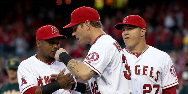 Erick Aybar, Josh Hamilton and Mike Trout greet one another prior to the start of the Angels' home opener against the Oakland Athletics.