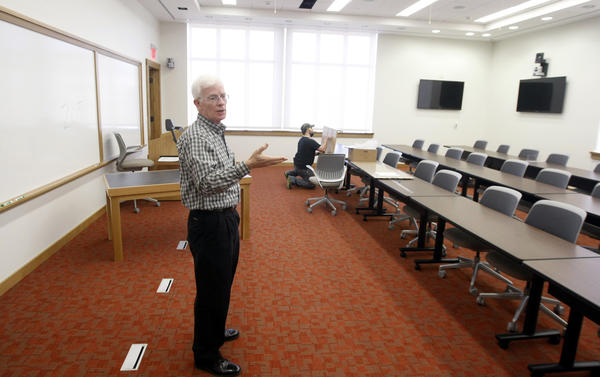 Paul Slaggert, director of non-degree executive education programs for the University of Notre Dame's Mendoza College of Business, shows one of the classrooms in the new Stayer Center for Executive Education.