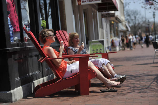 "Left to right, Courtney Foy and her mother, Kathy Foy, both of Millersville, enjoy ice cream cones and the sights along Main Street in Annapolis. Kathy says ""Today we're living life to its fullest."""
