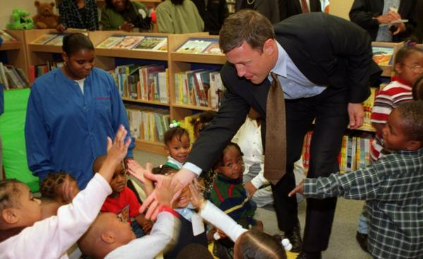 Baltimore mayoral candidate Martin O'Malley high fives kids from St. Veronica's headstart program at the Enoch Pratt Library at Cherry Hill Center during a tour with Governor Glendening.