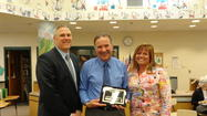 At the regular April 8, 2013 Frankfort School District 157-C Board of Education meeting, the Board recognized John Viano, the Executive Director of the Association of Illinois Middle Schools (AIMS.)  Mr. Viano presented the Board with a plaque for the recertification of Hickory Creek Middle School as a Horizon School to Watch.