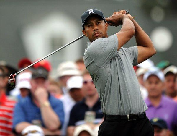 Tiger Woods swings during the first round of the 77th Masters on Thursday in Augusta, Ga.