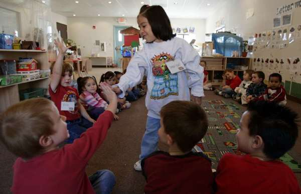 Marisol Paez, 4, high-fives her classmates at Valley View Elementary Preschool in Nuevo, Calif., in 2006. Valley View was the state's first universal preschool, which means all students can attend, regardless of income.