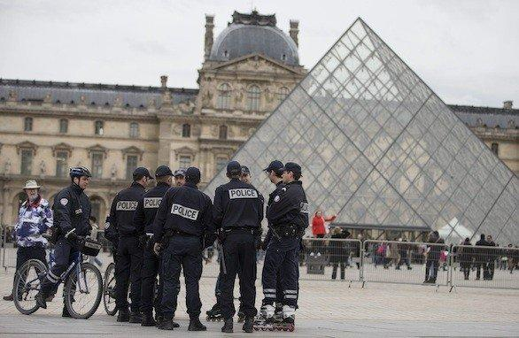 French police Thursday patrol outside the Louvre Museum in Paris, which reopened following a one-day closure. Staff walked out Wednesday to protest the rising number of pickpockets.