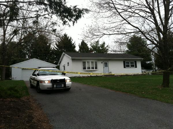 Crime scene tape surrounds the Herber Road home where police say 54-year-old Carol M. Albright was brutally beaten by her husband, James, on Wednesday. Carol Albright later died from her injuries.