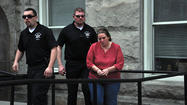 Lorrie Fisher escorted to jail