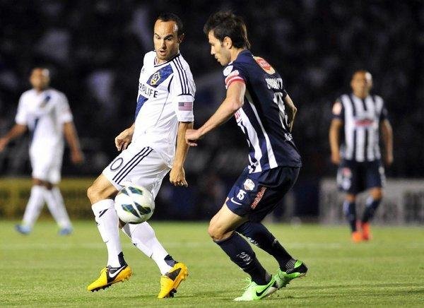 Landon Donovan vies for the ball with Monterrey's Jose Basanta during a Champions League game on Wednesday.