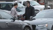 KPMG partner Scott I. London, left, is shown in FBI photograph allegedly accepting a $5,000 cash bribe from Bryan Shaw earlier this year. Federal prosecutors charge London with providing Shaw with inside information on two California companies, Herbalife Ltd. and Skechers USA Inc.