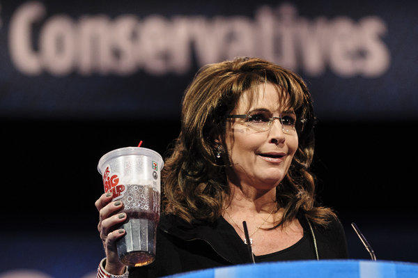 Former Alaska Gov. Sarah Palin holds up a large soda as she speaks about New York Mayor Michael Bloomberg's proposed ban on such drinks at the 2013 Conservative Political Action Conference in National Harbor, Md.