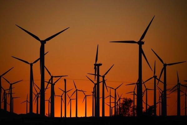 Giant turbines are powered by strong winds during sunset in Palm Springs last month. California installed enough new turbines in 2012 to climb to second place in the U.S. in wind power generation.