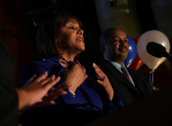With her husband Nate Horn by her side, Robin Kelly gives a speech after being declared winner in the 2nd Congressional District race on election night in Matteson on April 9, 2013.