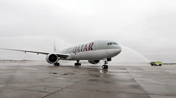 Qatar Airways first passenger flight to Chicago is greeted with a ceremonial water salute after it touches down at OHare on Wednesday, April 10.