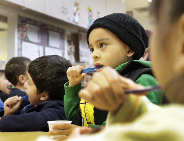 Derick Arciniega, 4, brushes his teeth along with his preschool classmates at Pacific Asian Consortium in Employment, an early childhood education program in Los Angeles, last month. President Obama has proposed to make preschool available to all low- and moderate-income Americans by increasing the tax on tobacco products.