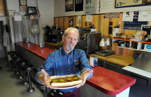 Ed Mertz, owner of George's Light Lunch for 22 years, holds one of his famous steak sandwiches in his restaurant at 308 West Broad Street in Bethlehem.