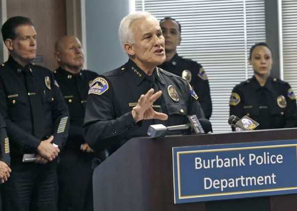 Burbank Police Chief Scott LaChasse talks the media at a holiday season press conference.