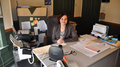 Ashley Dively sits at her desk at the Next Step Center in Somerset. Dively is finishing her second week as shelter manager.