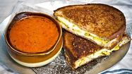 "Friday is National Grilled Cheese Day, the best of all food holidays, ever. And to celebrate, we have an entire day full of ways you can get your fill of crispy, butter-grilled bread and ooey, gooey cheese. We're whipping up grilled cheese trivia, our staff favorites, the best libations to pair with your sandwich, <a href=""http://www.latimes.com/features/food/la-fo-grilled-cheese-recipes-pictures,0,1349193.photogallery"">12 recipes</a> and, to start off, here's a list of places around town offering grilled cheese specials for the big day."