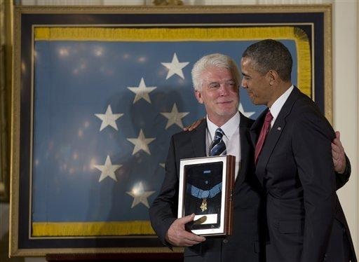 President Obama with Ray Kapaun, nephew of Korean War era Army Chaplain Emil J. Kapaun, who received the Medal of Honor posthumously for extraordinary heroism.