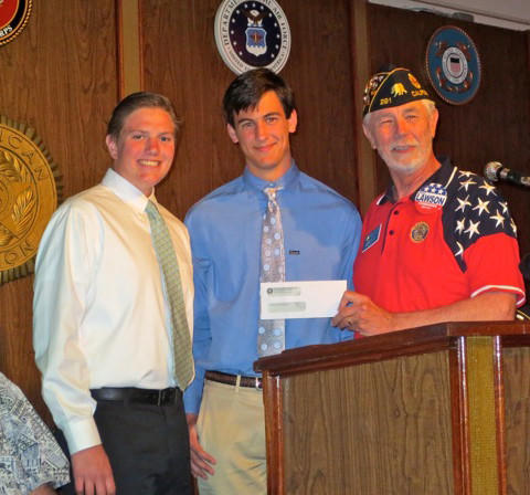 Colin Duffy and Cameron Geehr of Newport Harbor's Republican Club receive a check from American Legion Post Commander Jess Lawson.