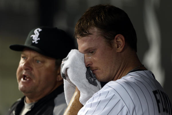 Chicago White Sox' Gavin Floyd and pitching coach Don Cooper react after Floyd gave up lead in 5th inning to Detroit Tigers during MLB game at US Cellular Field in Chicago on Wednesday, Sept. 12, 2012. (Scott Strazzante/Chicago Tribune) B582322542Z.1 ....OUTSIDE TRIBUNE CO.- NO MAGS, NO SALES, NO INTERNET, NO TV, CHICAGO OUT, NO DIGITAL MANIPULATION...