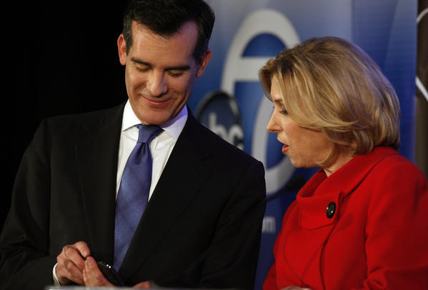Candidates for Los Angeles mayor Eric Garcetti, left, and Wendy Greuel, right, talk on stage before a mayoral debate in February at the Cal State Los Angeles' Pat Brown Institute of Public Affairs.
