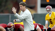 Lane Kiffin exited the field and hustled up several flights of stairs to greet USC football fans perched atop an observation deck overlooking the Trojans' practice facility.