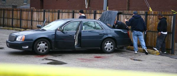 Chicago police investigate an attempted car jacking at 79th Street and Drexel Avenue.
