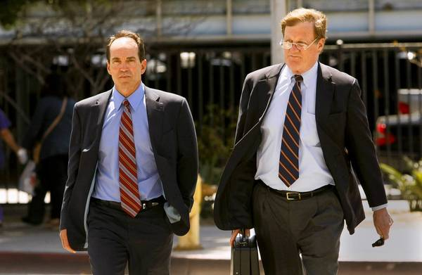 Scott London, left, and attorney Harland W. Braun walk to the federal courthouse in Los Angeles, where the former KPMG auditor was charged with conspiracy to commit securities fraud through insider trading.
