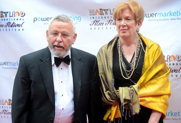"Tony Mendez and his wife, Jonna Mendez, pose for photographers Thursday night as they arrived at The Maryland Theatre for the screening of ""Argo"" and the kickoff of the second Maryland International Film Festival."