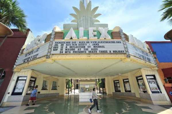 Pedestrians walk past the Alex Theatre on Tuesday, July 10, 2012. (Roger Wilson/Staff Photographer)
